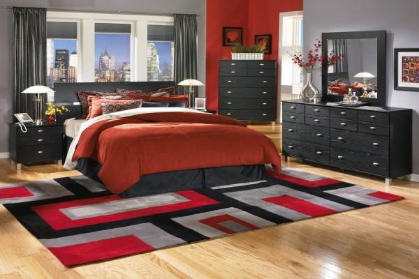 Мебель серого цвета прекрасно сочетается с терракотовым цветом текстиля