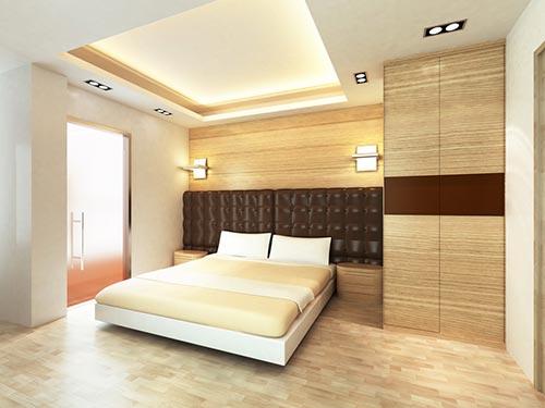 На фото отделка мдф панелями стен в спальне