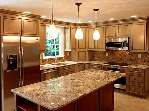 На фото подвесные светильники для кухни